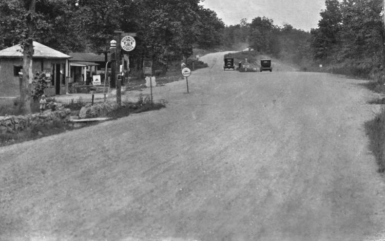 "For the first time in the seventeen-year history of the Route 66 Driving Tour brochure, it now includes detailed directions to Pulaski County's abandoned ""ghost section"", a short two-lane 1930's alignment at the former Morgan Heights community. Image courtesy of Joe Sonderman/www.66postcards.com."