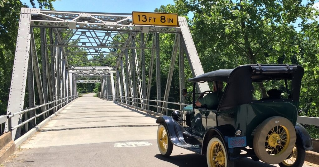 1926 Touring Model T crossing the Devils Elbow steel bridge on Route 66 in Pulaski County, Missouri.