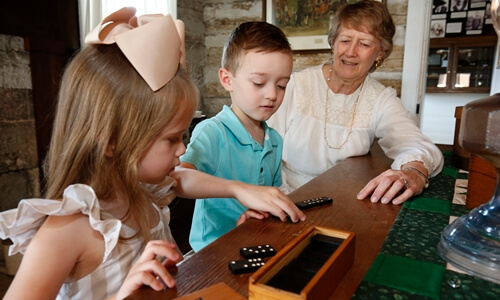 Children playing with dominoes at Old Stagecoach Stop, Waynesville Missouri