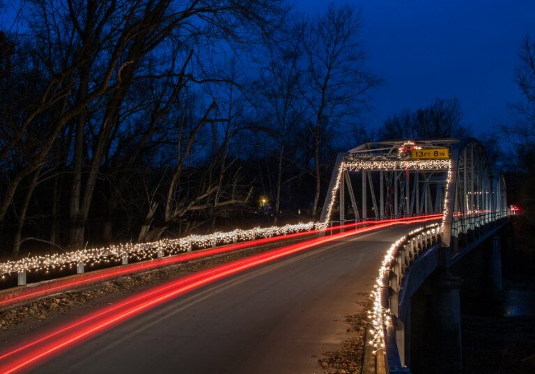 Christmas lights adorn Devils Elbow bridge over the Big Piney river